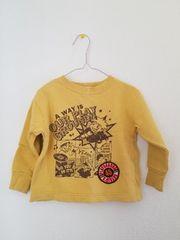 黄色に茶色もようの長袖トレーナー100