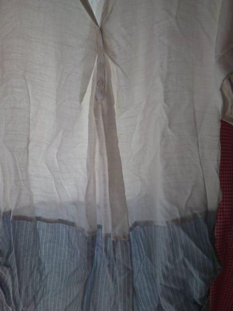 新品タグつきチュニックシャツ★ < 女性ファッションの